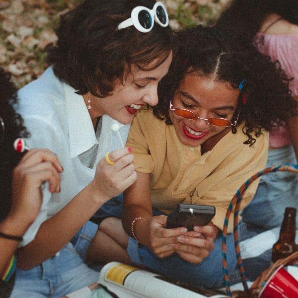 Teens looking at mobile phone.